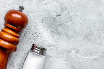 salt in glass bottle on gray table background top view space for