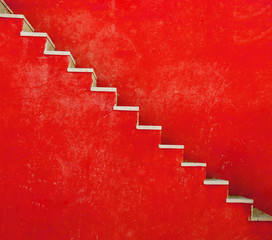 Red wall with stairs texture background, minimalistic style for base image for posters, banners or covers, trivial design and simplicity is a trendy key for graphic arts, acid psychedelic color