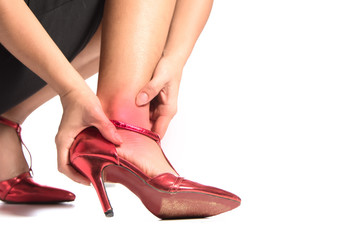 ankle sprain on white background, young woman pain with inflammation right ankle, woman using high heels shoes and pain from ankle sprain