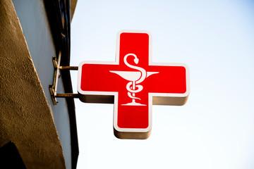 Pharmacy sign on a blue sky background