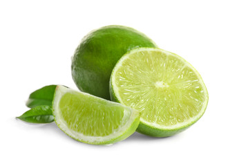 Fresh ripe green limes on white background