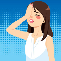 Disappointed young woman covering face with hand making facepalm gesture negative emotion facial expression