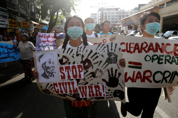Students take part in a rally demanding peace at the war-torn Kachin State in Yangon