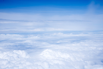 Airplane view above the clouds