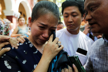 Pan Ei Mon, wife of detained Reuters journalist Wa Lone, reacts after a court hearing in Yangon