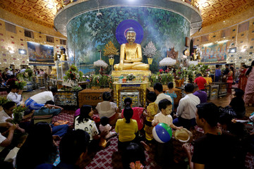 People pray at Kaba Aye Pagoda during Myanmar's new year, in Yangon