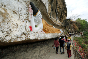 Local people visit Akauk Taung pagodas which were craved in the cliff outside Pyay, Magway District