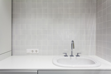 Element of bathroom interior. New wash basin, white sink and tile. Fototapete