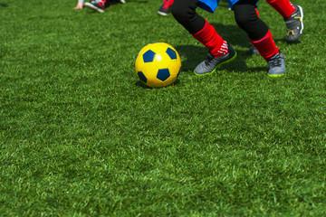 Boys playing football on sports field