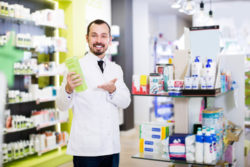 Pharmacist showing right pills in drugstore