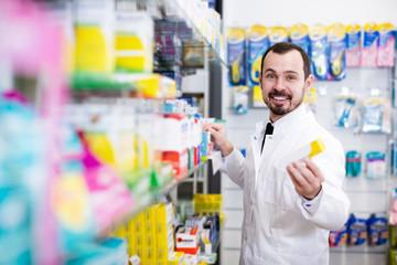 Positive man pharmacist offering right drug