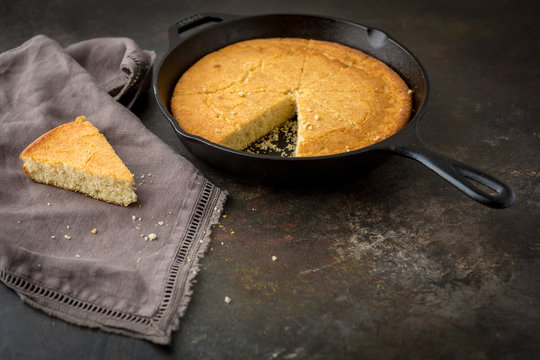 Homemade Buttermilk Cornbread in a Cast Iron Skillet on a Dark Background