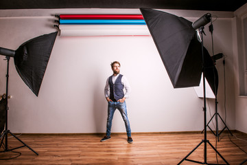 Portrait of a young hipster man or model in a studio. Copy space.