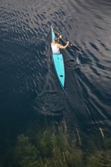 person kayaking on a lake in styria, austria