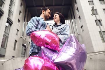 Couple in love near balloons.