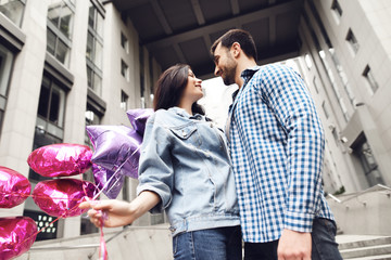 Happy young couple walking around the city.
