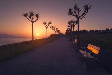 Benches in La Galea park in Getxo at sunset