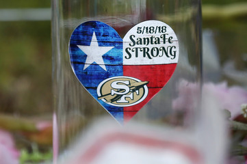 A sticker is seen at a makeshift memorial left in memory of the victims killed in a shooting at the Santa Fe High School in Santa Fe
