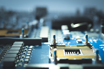 electronic circuit board background. technology style information abstract concept semiconductor motherboard computer blue design microchip digital processor and science close up