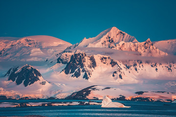 Wall Mural - The Antarctic peninsula mountain range that was shot during the extreme expedition to the Vernadsky Research Base. The beauty of snow-covered mountain crest and Pacific Ocean.
