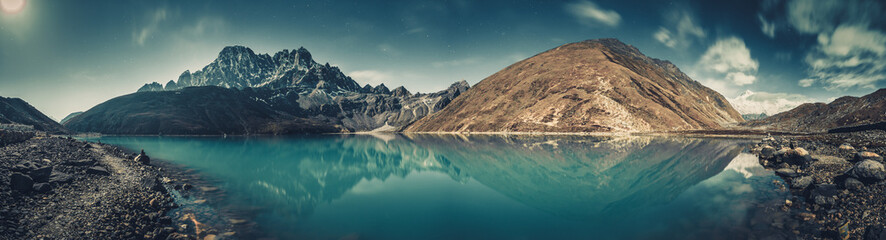 Spectacular scenery the crystal clear Gokyo Lake on the mighty snow-covered Himalayas background....