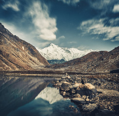 Wall Mural - Breathtaking scene the crystal clear Gokyo Lake and snow-covered Himalayas in grey blue shades. The protected area of the Sagarmatha National Park in north-eastern Nepal.
