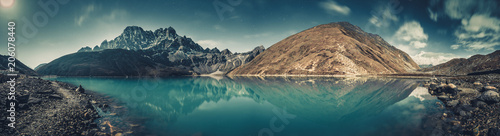 Wall mural Spectacular scenery the crystal clear Gokyo Lake on the mighty snow-covered Himalayas background. Strength and beauty of wild virgin nature. Ideal image for the backgrounds and wallpapers.