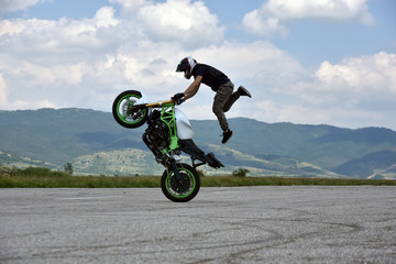 Stunt motorcyclist in action
