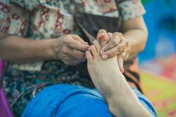 Thai foot massage on street for resting place on annual festival.