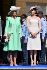 Meghan, Duchess of Sussex attends a garden party at Buckingham Palace, with Camilla the Duchess of Cornwall, in London