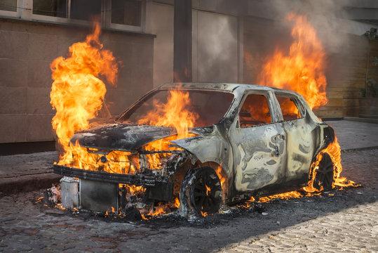 Fire engulfing a car