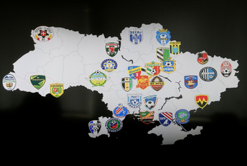 Logos of Ukrainian football clubs, suspected by National Police to be involved in match-fixing, are  seen on a monitor during a news conference at the police headquarters in Kiev