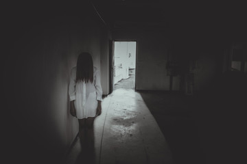 Close up woman wear white shirt in the dark room,Scary movie concept,Horror background,Thailand people