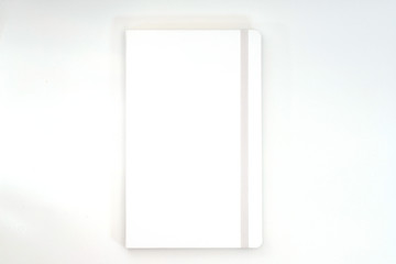 """Blank photorealistic notebook mockup on light grey background, 3d  illustration."""