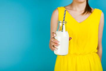 Woman holding a bottle of milk