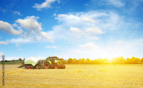 Wall mural tractor on field