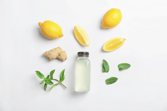 Flat lay composition with delicious natural lemonade on white background