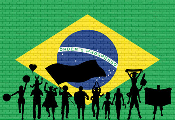 Brazilian supporter silhouette in front of brick wall with Brazil flag