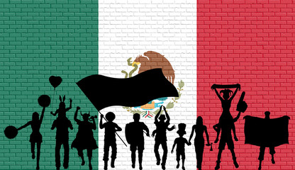 Mexican supporter silhouette in front of brick wall with Mexico flag