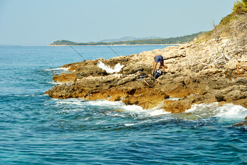 Fisherman on a Rocky Adriatic Coast