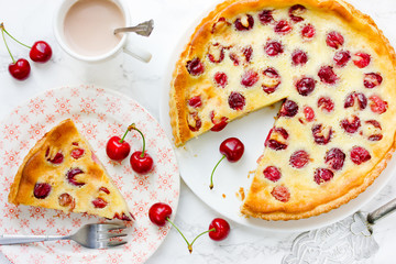 Cherry pie with cream filling, french dessert clafoutis with red sweet cherries