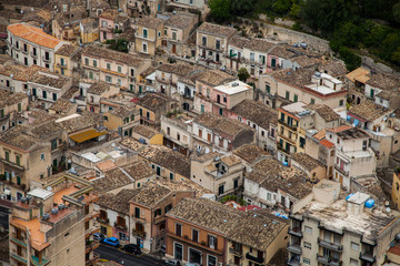 Colorful houses and streets in old medieval village Ragusa in Sicily, Italy.