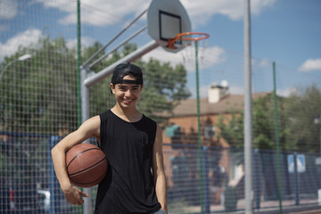 Young Man Holding a Basketball Ball