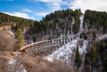 An old wooden trestle running through the mountains in New Mexico.