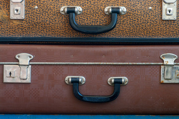 Two old suitcases on top of each other. Close up.