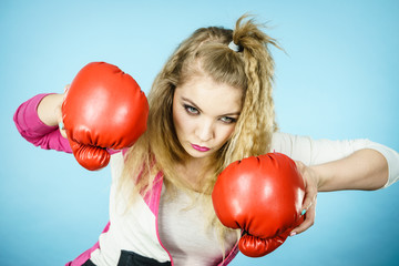 Funny woman wearing boxing gloves