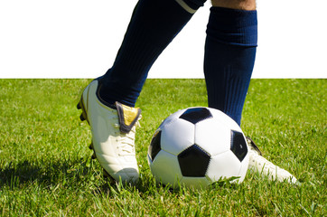 Legs of football player, soccer player and soccer ball isolated white background with copy space use for sport and athletic topic