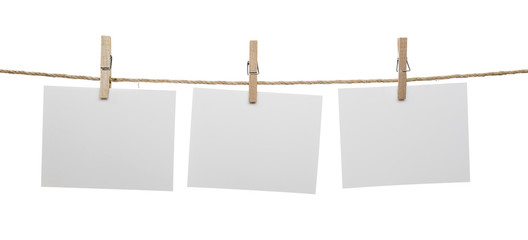 White blank cards with copy space on rope isolated on white background.
