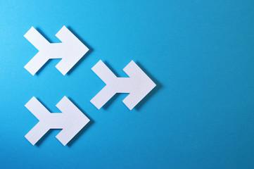 three arrows on blue background