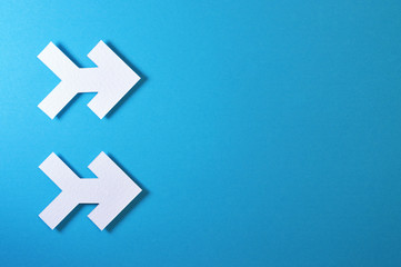 two arrows on blue background